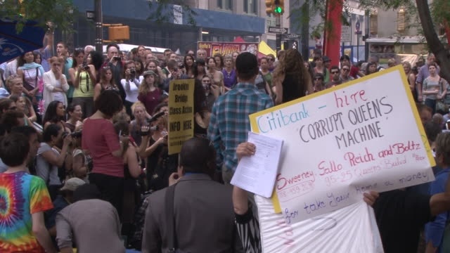 large group of occupy wall street protesters chant together in zuccotti park in lower manhattan. - occupy protests stock videos & royalty-free footage