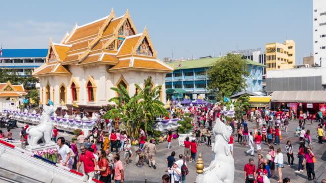 Large Group Of People Crowded At Wat Traimit In Yaowarat Road, Bangkok, Thailand