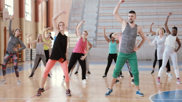 large group of people dancing at zumba class - dance studio stock videos & royalty-free footage