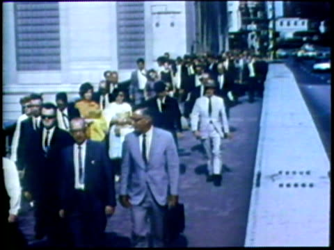 1973 montage ws ms large group of people on sidewalk/ ha ws zi people disembarking from train/ usa/ audio - 1973 stock videos & royalty-free footage