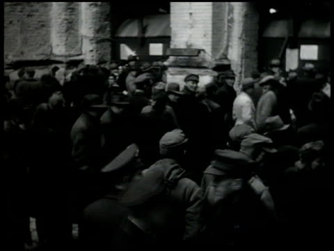 large group of people standing outside railroad station displaced refugee man woman teenager w/ belonging bundles outside train station ms man... - postwar stock videos and b-roll footage