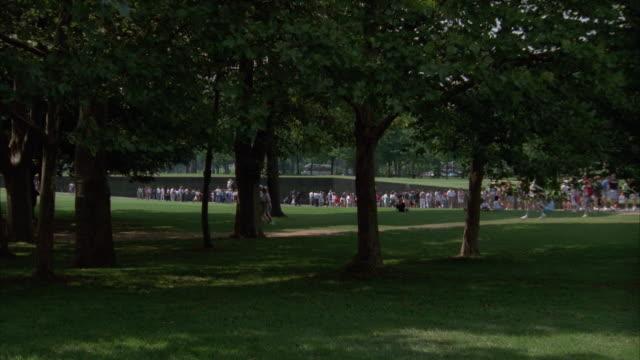 MS large group of people walking at Vietnam Veterans National Memorial, Washington, D.C., USA