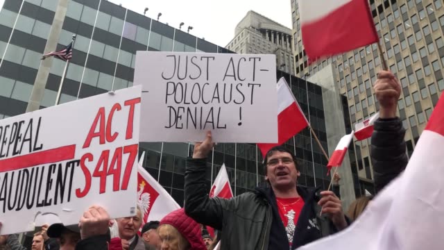 a large group of polish nationalists hold a protest in a major square in downtown manhattan on sunday march 31 protesting us legislation that seeks... - patriotism stock videos & royalty-free footage