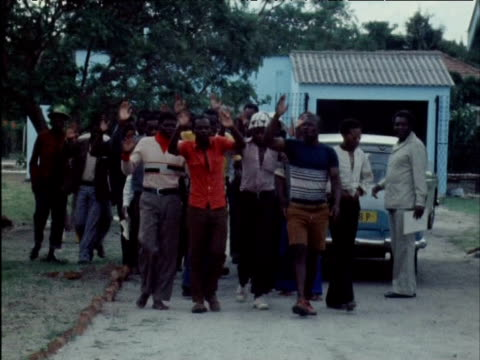 large group of political prisoners are released from prison after being accused of acting as guerilla fighters for joshua nkomo's party 1970s - joshua nkomo stock videos & royalty-free footage