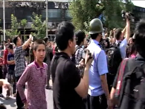 large group of protesters gathered in streets following violent clashes with police 7 july 2009 - 新疆ウイグル自治区点の映像素材/bロール