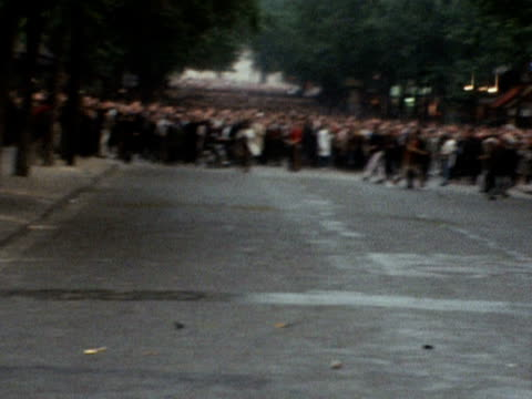 a large group of students riot in the streets of paris 1968 - 1968 stock-videos und b-roll-filmmaterial