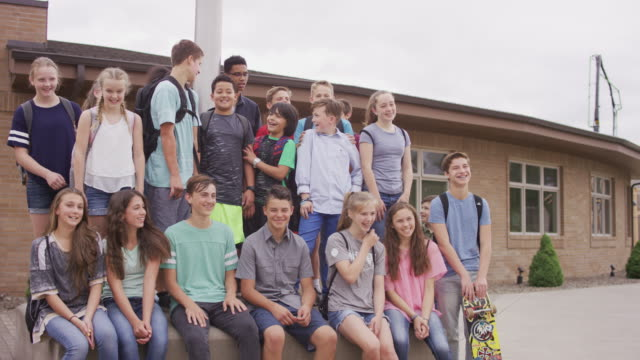 large group of students sitting around flag pole - junior high stock videos & royalty-free footage
