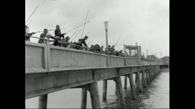 large groups of men and boys fishing on pier; 1958 - fishing stock videos & royalty-free footage