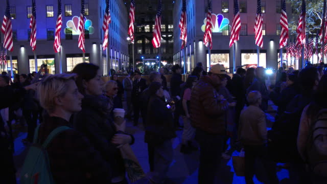 large groups of mostly hillary clinton supporters gather to watch the election results on big screen televisions at rockefeller center on election... - presidential election stock videos & royalty-free footage