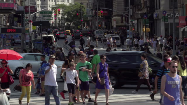 large groups of pedestrians use crosswalk along broadway avenue near union square in new york city. - union square new york city stock videos & royalty-free footage