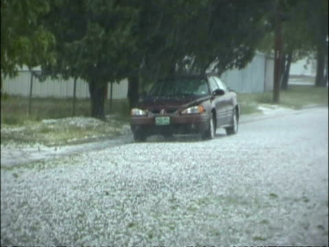 stockvideo's en b-roll-footage met ms large hail stones falling on parked car and road, usa - beschadigd