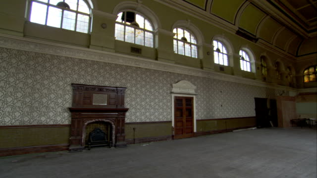 a large hall at the high royds hospital features arched windows and a fireplace, yorkshire. available in hd. - doorway stock videos and b-roll footage