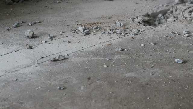 a large hammer is hitting the concrete floor violently. - strike industrial action stock videos & royalty-free footage