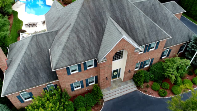 large house three hundred sixty degree aerial 4k video - roof stock videos & royalty-free footage