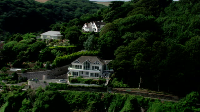 Large houses dot the hillside above the southwest coast of England. Available in HD.