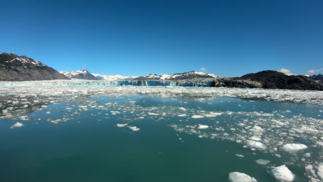 large ice covered ocean area broken from glacier - pacific war stock-videos und b-roll-filmmaterial