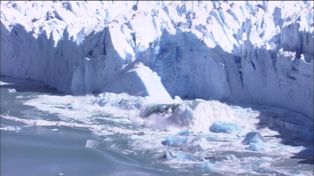 large ice form surfaces and floats as perito moreno glacier calves, patagonia - patagonia chile stock videos and b-roll footage