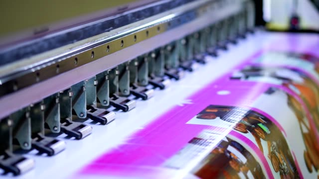 large inkjet printer working on vinyl banner - printing plant stock videos & royalty-free footage