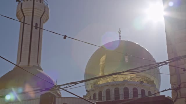 large islamic mosque with golden turrets in an islamic city in israel - arabic script stock videos & royalty-free footage