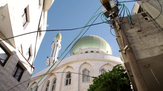 large islamic mosque with golden turrets in an islamic city in israel - dome stock videos & royalty-free footage