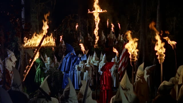 ms large ku klux klan men gathering in  woods  with  burning crosses and torches - ku klux klan stock videos and b-roll footage