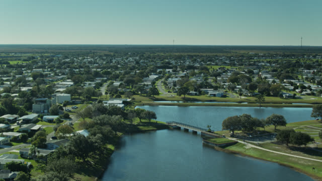 large manufactured home community around lagoon in florida - florida us state stock videos & royalty-free footage