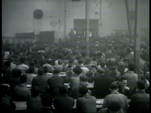 large meeting of workers in smoky room male talking behind microphone ws people listening union labor meeting - labor union stock videos and b-roll footage