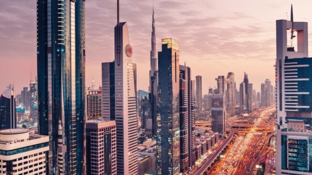 large megacity cityscape timelapse in sunset - traffic stock videos & royalty-free footage
