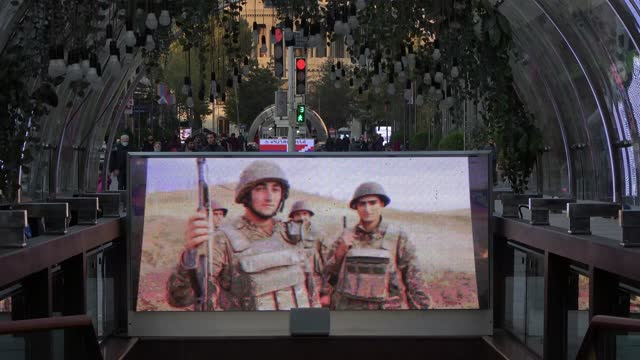 large monitor placed at the northern avenue plays a loop of armenian soldiers during the military conflict between armenian and azerbaijani forces... - eddie large stock videos & royalty-free footage