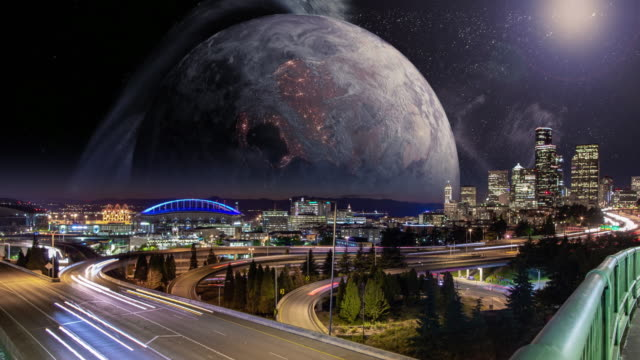 large moon rising over seattle city skyline - moody sky stock videos & royalty-free footage