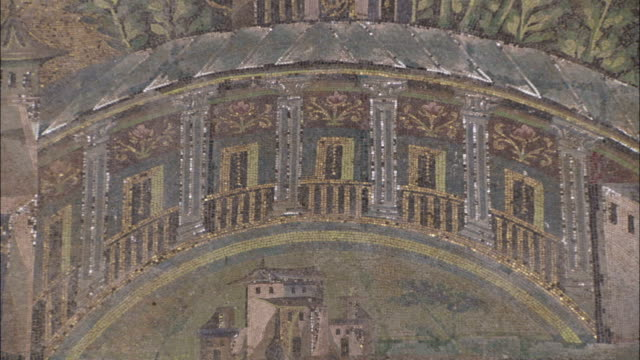A large mosaic frieze in the Umayyad Mosque depicts temples buildings and trees next to a river. Available in HD.