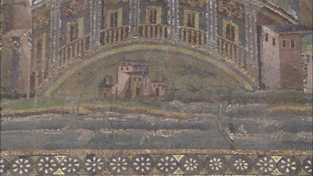 A large mosaic frieze located in the Umayyad Mosque courtyard depicts temples by a river. Available in HD.