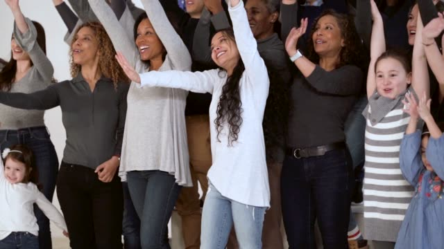 large multi ethnic group waving arms in air - celebratory event stock videos & royalty-free footage