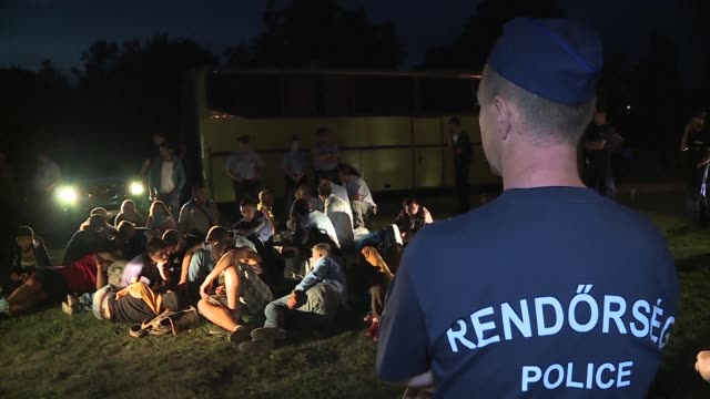 a large number of migrants were held for more than five hours by local hungarian police at the nagyszentjanos train station as they refused to go to... - eastern european culture stock videos and b-roll footage