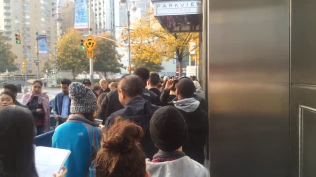 a large number of people waited on line for the coveted balmain x hm collection outside of the time warner building in columbus circle in manhattan - bizarre fashion stock videos and b-roll footage