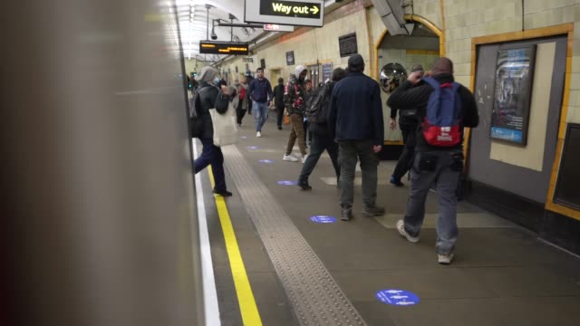 large numbers of people leave a transport for london underground train after the prime minister announced the general contours of a phased exit from... - commuter stock videos & royalty-free footage