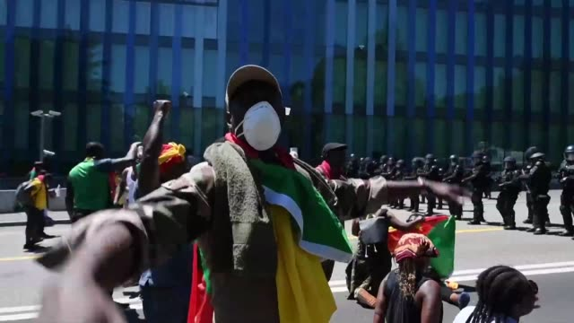 large numbers of police in riot gear use water cannons tear gas and stun grenades against anti-biya protesters in geneva - water cannon stock videos & royalty-free footage