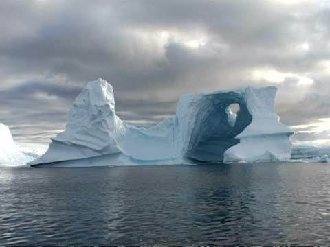 ms large oddly shaped iceberg, antarctic peninsula - antarctic peninsula stock videos & royalty-free footage