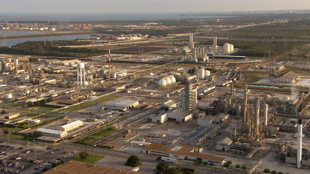 a large oil refinery complex nestles near factories in houston, texas. - texas stock videos & royalty-free footage