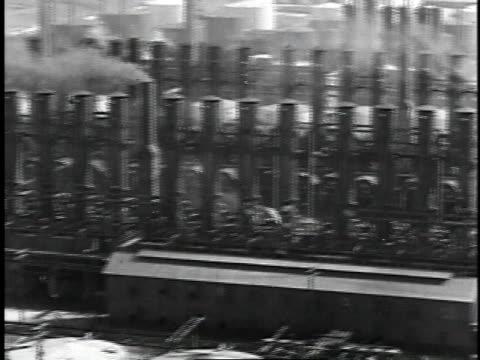 1929 montage a large oil refinery / united states - 1920~1929年点の映像素材/bロール