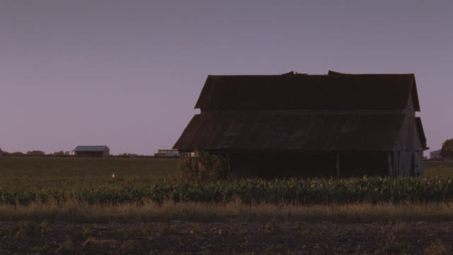 a large old farmhouse occupies farmland in texas. - farmhouse stock videos & royalty-free footage