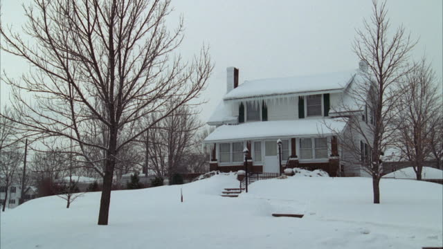 WS Large older wooden two story house in winter