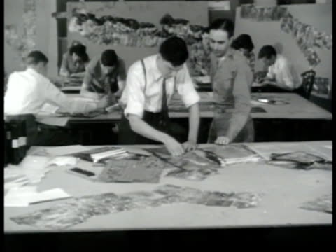 stockvideo's en b-roll-footage met large open office w/ people working at tables male aerial photo analyst standing working at table alone ms male hands matching aerial photographs... - 1943