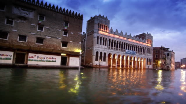 a large, ornate building on the grand canal - boat point of view stock videos & royalty-free footage