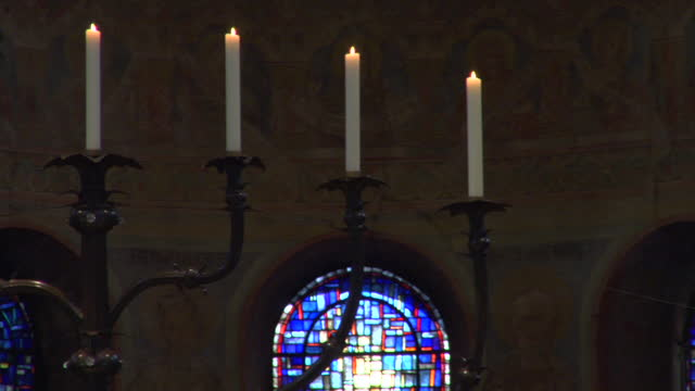 large ornate candelabra on the alter of a medieval church in germany. - candle stock videos & royalty-free footage