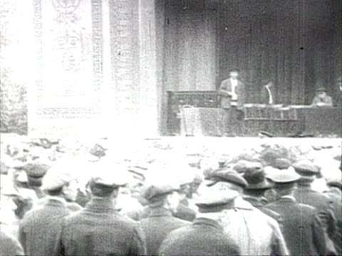 large outside meeting with men at tribune audio/ russia - anno 1925 video stock e b–roll