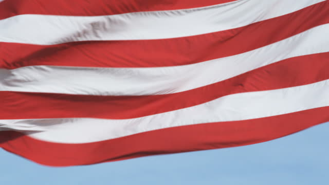 large oversized american flag blowing in the wind - オレム点の映像素材/bロール