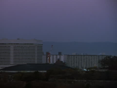 a large pagoda stands near high rises in a city. - pagoda stock videos & royalty-free footage