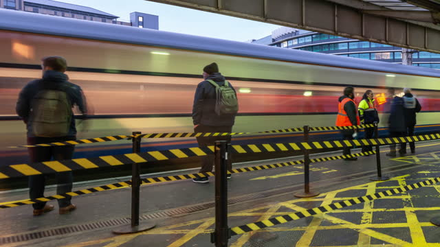 a large painted exclusion zone helps to control the flow of commuters as they arrive on a station platform during the evening rush hour at manchester piccadilly station - station stock videos & royalty-free footage