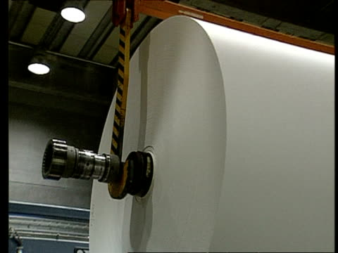 large paper roll on machine being moved into position - pulp stock videos & royalty-free footage